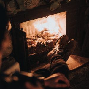 Relaxing by a fireplace
