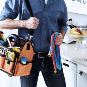 Plumber carrying tools